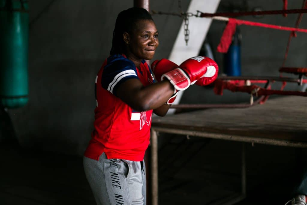 11 July 2019: Edith Agu Ogoke, warms up for sparring in the National Stadium gym, Lagos, Nigeria